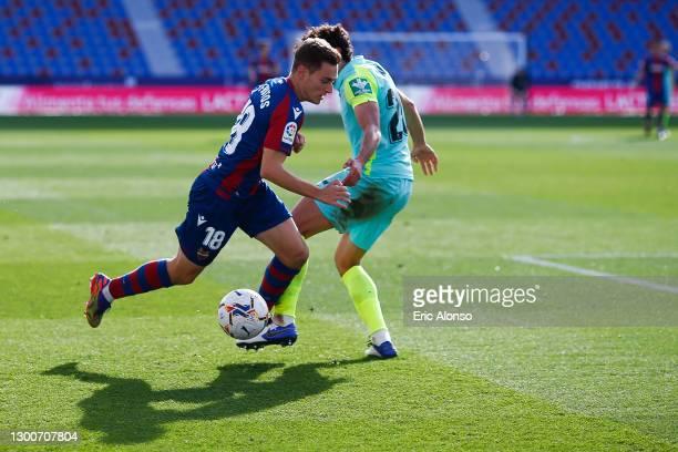 Jorge de Frutos of Levante UD dribbles Jesús Vallejo of Granada CF during the La Liga Santander match between Levante UD and Granada CF at Ciutat de...