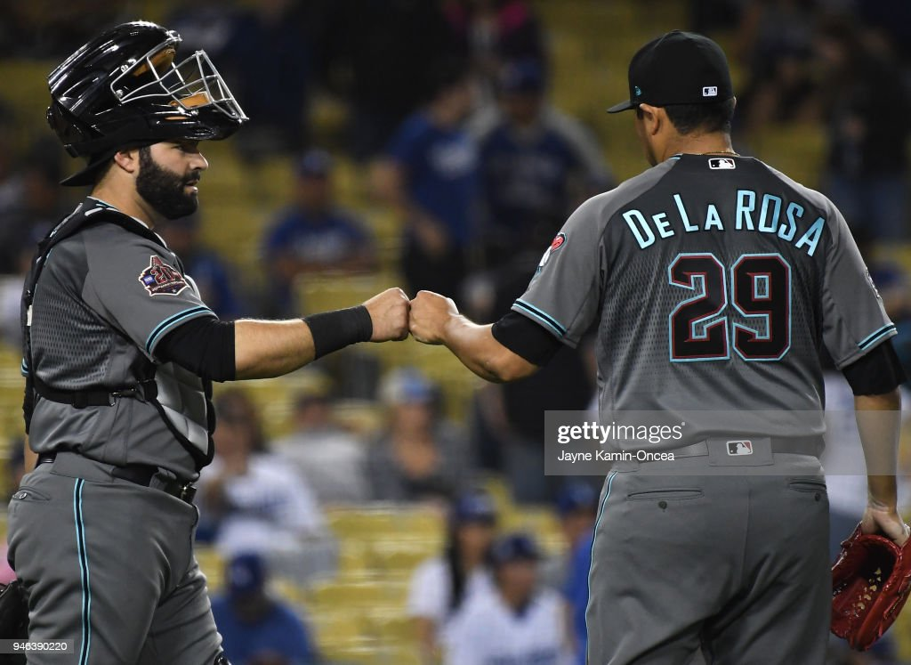 Jorge De La Rosa #29 gets a fist pump from Alex Avila #5 of the Arizona Diamondbacks after earning a save in the ninth inning of the game against the Los Angeles Dodgers at Dodger Stadium on April 14, 2018 in Los Angeles, California.