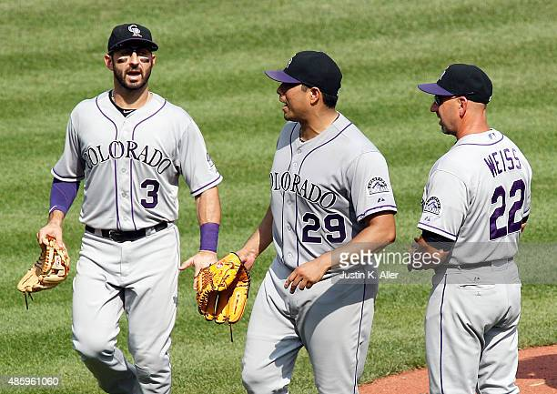 Jorge De La Rosa of the Colorado Rockies yells at the home plate umpire while being removed from the game by manager Walt Weiss in the seventh inning...