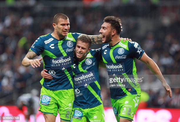 Jorge Enriquez Diego Cruz of Puebla and Lucas Cavallini of Puebla celebrate the third goal of their team during the 10th round match between...