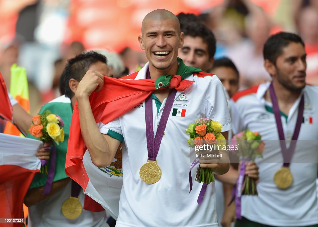Jorge Enriquez of Mexico celebrates winning the gold medal after the Men's Football Final between Brazil and Mexico on Day 15 of the London 2012 Olympic Games at Wembley Stadium on August 11, 2012 in London, England.