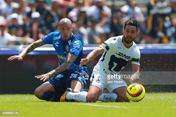 Jorge Enriquez of Puebla and Luis Quintana of Pumas fight for the ball during the 15th round match between Pumas UNAM and Puebla as part of the...