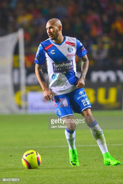 Jorge Enriquez of Puebla drives he ball during the second round match between Morelia and Puebla as part of the Torneo Clausura 2018 Liga MX at...