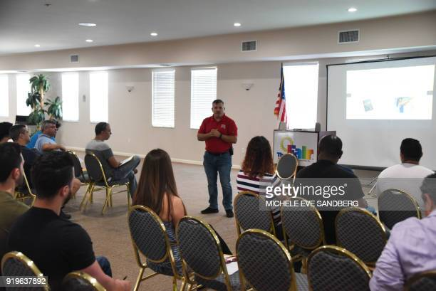 Jorge Fernandez teaches a weapons class during the South Florida Gun Show at Dade County Youth Fairgrounds in Miami Florida on February 17 2018 The...