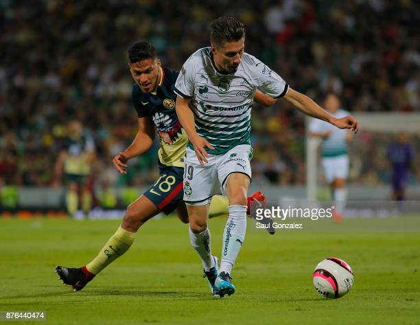 Jorge Flores of Santos fights for the ball with Bruno Valdez of America during the 17th round match between Santos Laguna and America as part of the...