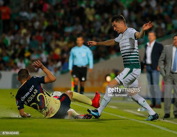 Jorge Flores of Santos fights for the ball with Paul Aguilar of America during the 17th round match between Santos Laguna and America as part of the...