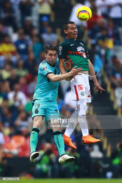 Jorge Flores of Santos Laguna struggles for the ball with Paul Aguilar of America during the 17th round match between America and Santos Laguna as...