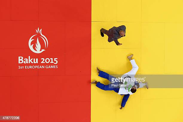 Jorge Fonseca of Portugal is thrown and loses his fight against Toma Nikiforov of Belgium in the Men's Judo 100kg Bronze Final during day fifteen of...