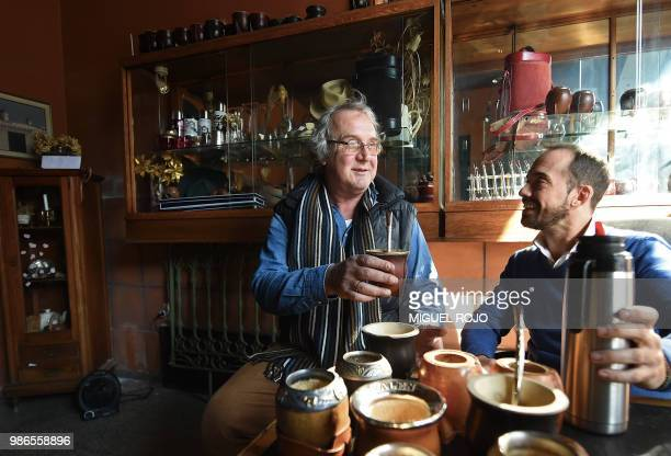 Jorge Francisco and Federico Bresciani manager and owner of traditional handmade silverware store Bresciani drink mate at the store in Montevideo on...