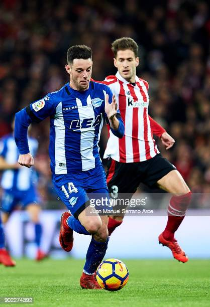 Jorge Franco 'Burgui' of Deportivo Alaves competes for the ball with Enric Saborit of Athletic Club during the La Liga match between Athletic Club...