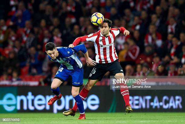 Jorge Franco 'Burgui' of Deportivo Alaves competes for the ball with Xabier Etxeita of Athletic Club during the La Liga match between Athletic Club...
