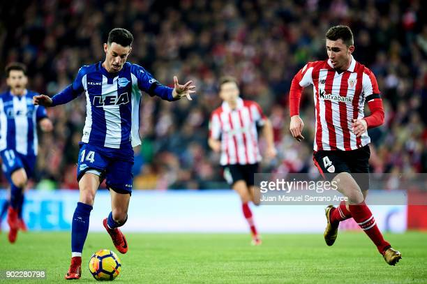 Jorge Franco 'Burgui' of Deportivo Alaves competes for the ball with Aymeric Laporte of Athletic Club during the La Liga match between Athletic Club...