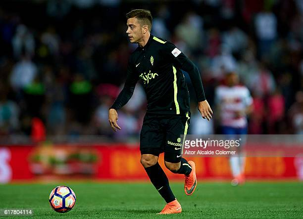 Jorge Franco 'Burgui' of Sporting Gijon in action during the match between Granada CF vs Sporting Gijon as part of La Liga at Nuevo los Carmenes...