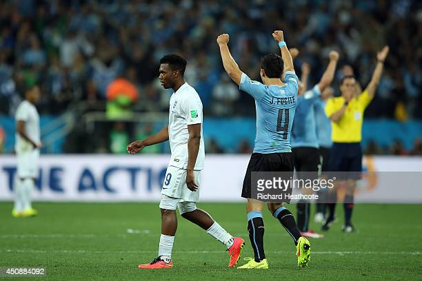 Jorge Fucile of Uruguay celebrates as a dejected Daniel Sturridge of England looks on after Uruguay's 21 win during the 2014 FIFA World Cup Brazil...