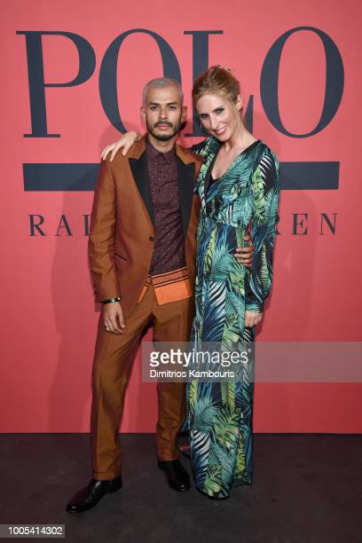 Jorge Gallegos and guest attend the Polo Red Rush Launch Party with Ansel Elgort at Classic Car Club Manhattan on July 25 2018 in New York City