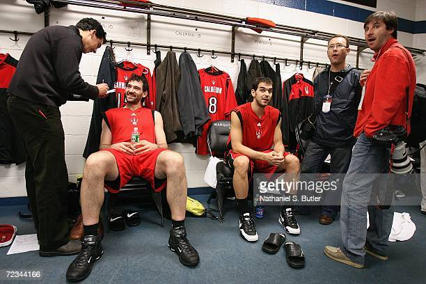 Jorge Garbajosa and Jose Calderon of the Toronto Raptors speaks to the media prior to the game against the New Jersey Nets on November 1 2006 at...