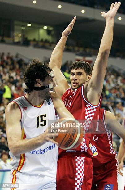 Jorge Garbajosa from Spain is guarded by Nikola Prkacin from Croatia during the FIBA EuroBasket 2005 quarter final match between Spain and Croatia on...