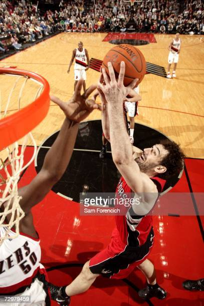 Jorge Garbajosa of the Toronto Raptors attempts to rebound the ball near Zach Randolph of the Portland Trail Blazers on December 22, 2006 at the Rose...