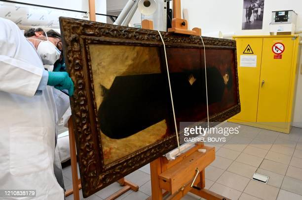 """Jorge Garcia Gomez-Tejedor, head of the restoration department, works on """"Full Body Self-Portrait"""" by Spanish painter Marisa Roesset Velasco in his..."""