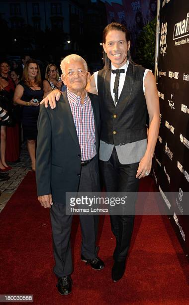 Jorge Gonzalez and his father Miguel pose on the red carpet before the dance gala performance 'Night Of The Stars 2013' on September 7 2013 in...