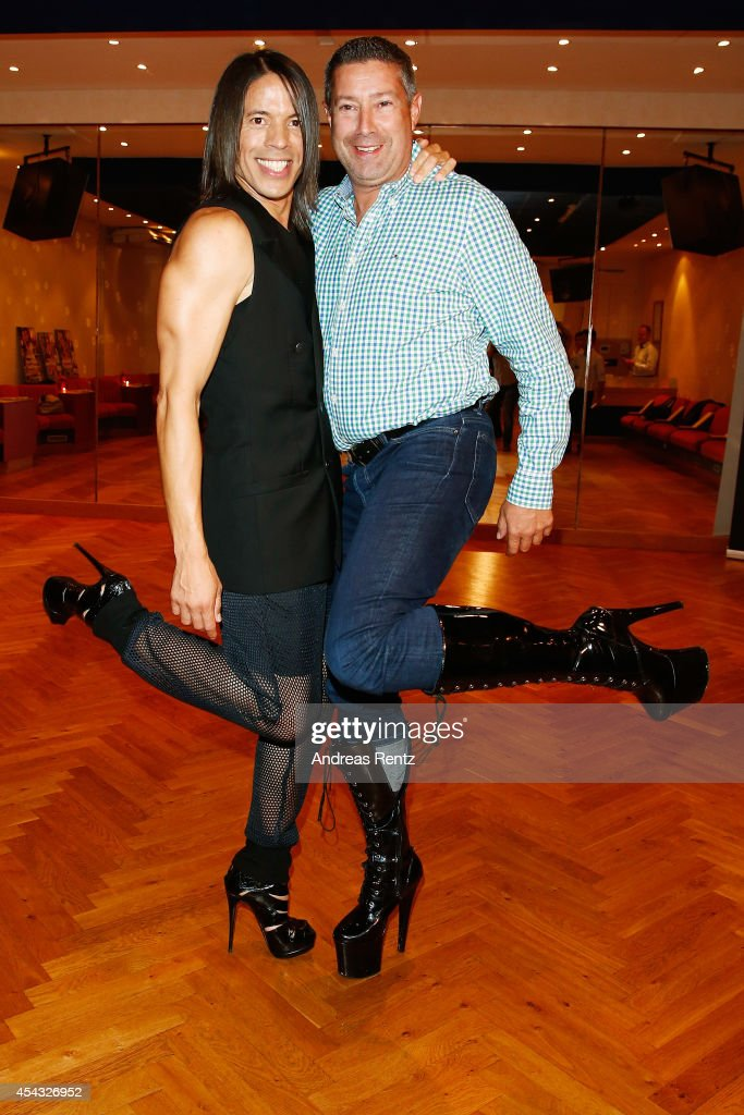 Jorge Gonzalez and Joachim Llambi pose together in high heel shoes during the IN Magazin Dance Club event at dancing school Reichelt on August 28, 2014 in Duesseldorf, Germany.