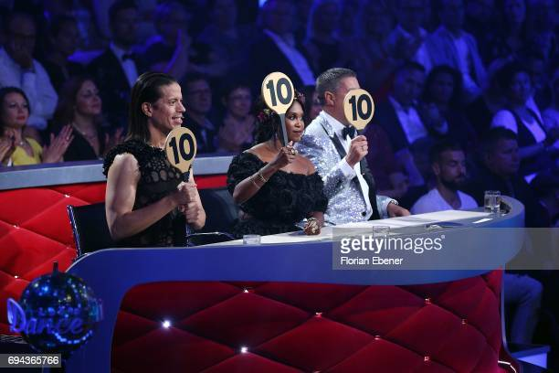 Jorge Gonzalez Motsi Mabuse and Joachim Llambi perform on stage during the final show of the tenth season of the television competition 'Let's Dance'...