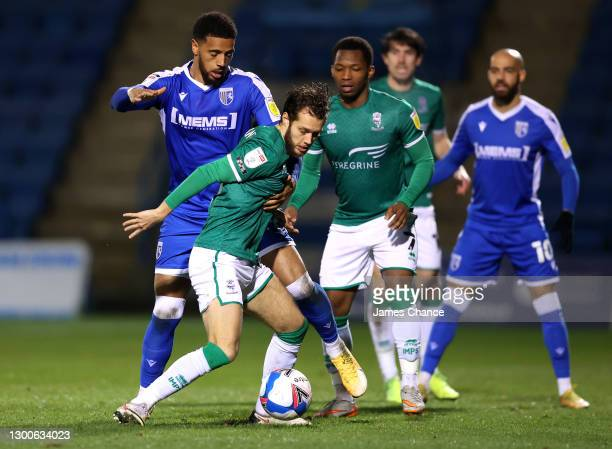 Jorge Grant of Lincoln City is challenged by Vadaine Oliver of Gillingham FC during the Sky Bet League One match between Gillingham and Lincoln City...