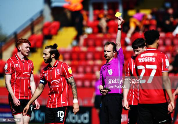 Jorge Grant of Lincoln City is shown the Yellow Card during the Sky Bet League One match between Lincoln City and Hull City at Sincil Bank Stadium on...