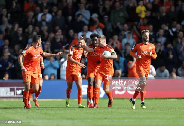 Jorge Grant of Luton Town celebrates with his team mates after scoring a goal to make it 11 during the Sky Bet League One match between Luton Town...