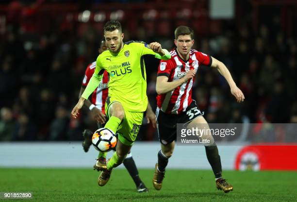 Jorge Grant of Notts County and Chris Mepham of Brentford in action during the The Emirates FA Cup Third Round match between Brentford and Notts...