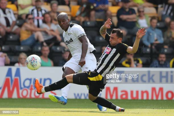 Jorge Grant of Notts County attempts to block a cross from Andre Wisdom of Derby County during a PreSeason match between Notts County and Derby...