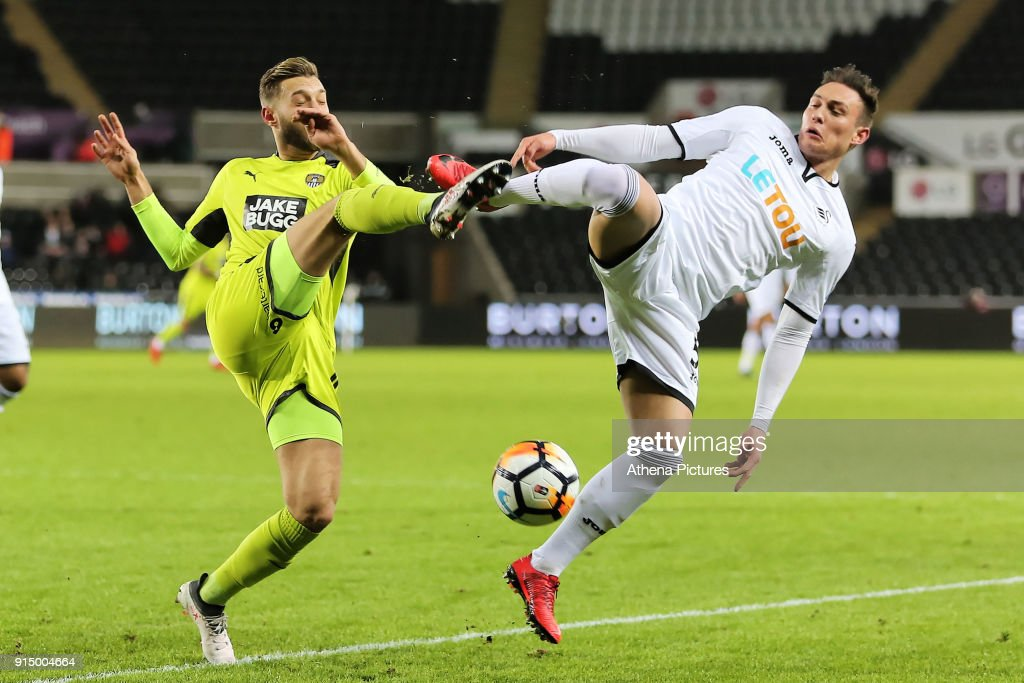 Jorge Grant of Notts County challenges Connor Roberts of Swansea City during The Emirates FA Cup match between Swansea City and Notts County at The Liberty Stadium on February 06, 2018 in Swansea, Wales.