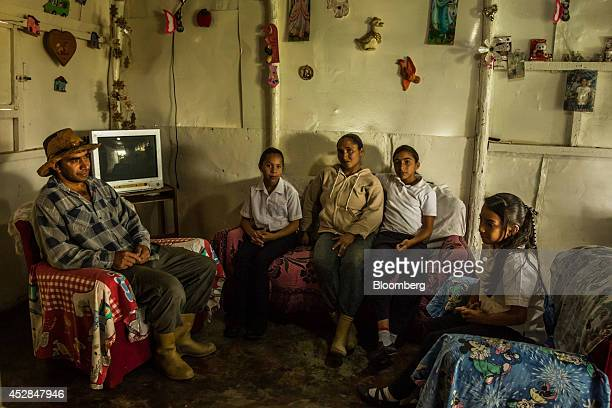 Jorge Graterol poses for a portrait in his home with his wife Marlene Reyes center and daughters from left Niurka Susana Natali and Edith Yorleni in...