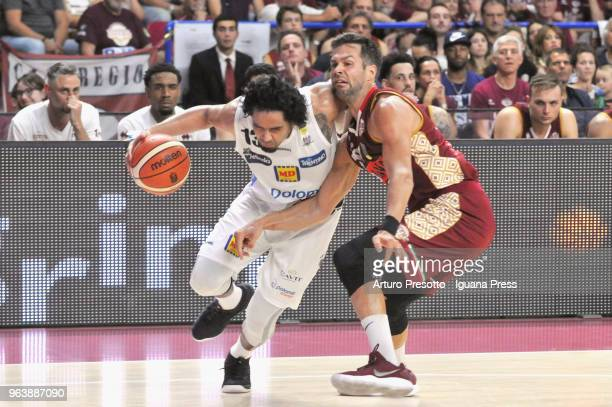 Jorge Gutierrez of Dolomiti Energia competes with Bruno Cerella of Umana during the LBA Legabasket of Serie A match play off semifinal game 1 between...
