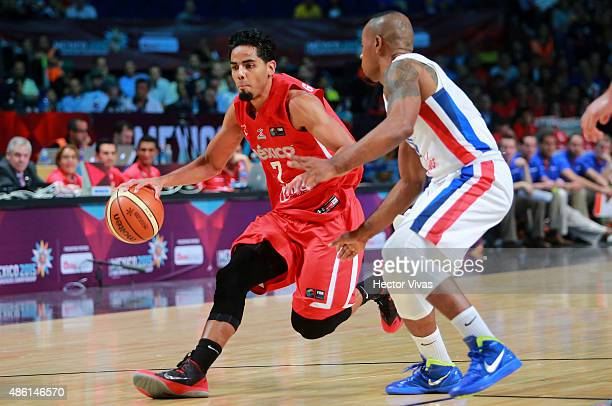 Jorge Gutierrez of Mexico handles the ball against Luis Flores of Dominican Republic during a match between Mexico and Dominican Republic as part of...