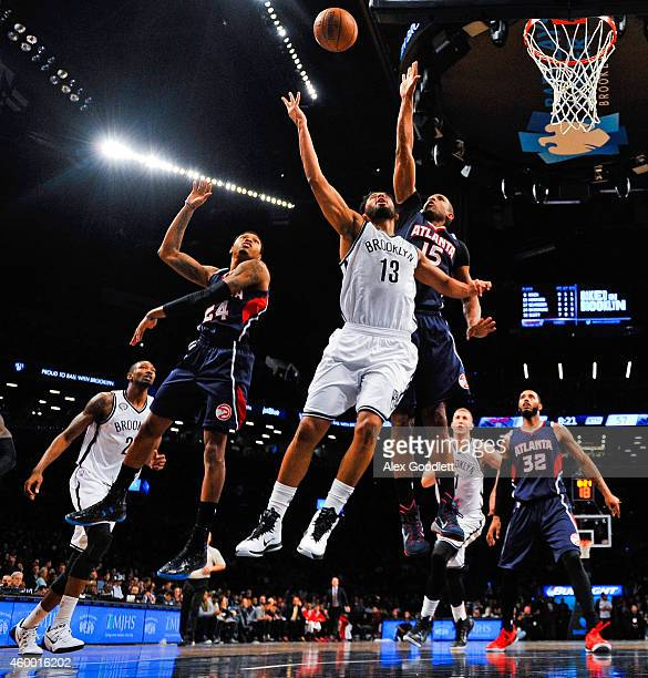 Jorge Gutierrez of the Brooklyn Nets attempts a rebound with Al Horford of the Atlanta Hawks in the second half at the Barclays Center on December 5...