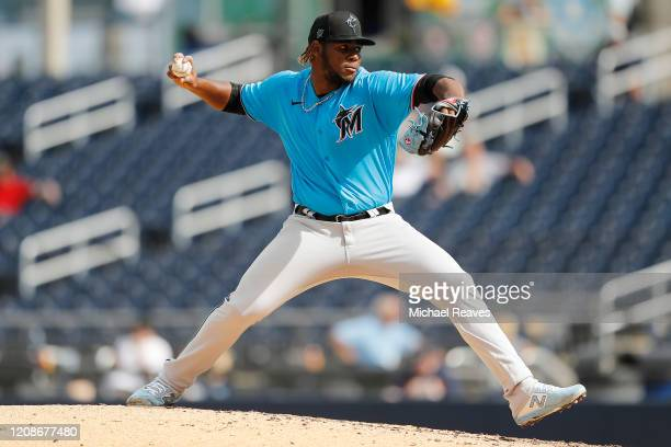 Jorge Guzman of the Miami Marlins delivers a pitch against the Houston Astros in the sixth inning of a Grapefruit League spring training game at...
