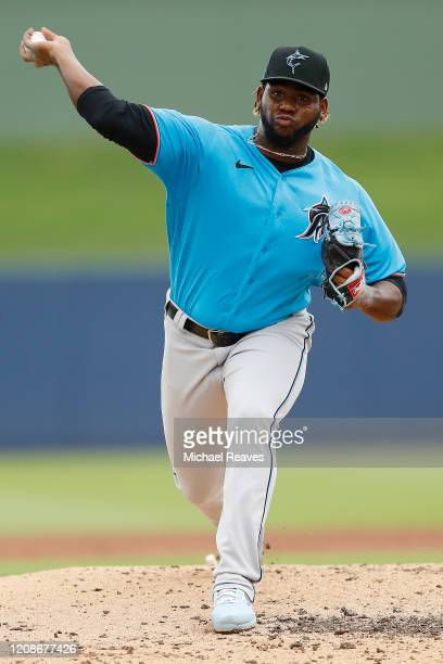 Jorge Guzman of the Miami Marlins warms up against the Houston Astros during a Grapefruit League spring training game at FITTEAM Ballpark of The Palm...