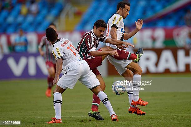 Jorge Henrique and Nene of Vasco battles for the ball with Jean of Fluminense during the match between Vasco and Fluminense as part of Brasileirao...