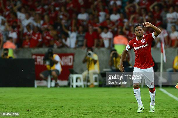 Jorge Henrique of Internacional celebrates after scoring the second goal of his team during a match between Internacional and U de Chile as part of...