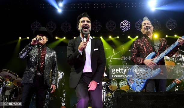 Jorge Hernandez , Hernan Hernandez of Los Tigres del Norte and Alejandro Fernandez perform during 'Rompiendo Fronteras' tour at Amway Center on...