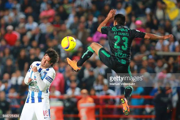Jorge Hernandez of Pachuca struggles for the ball against Jose Vasquez of Santos during the 15th round match between Pachuca and Santos Laguna as...