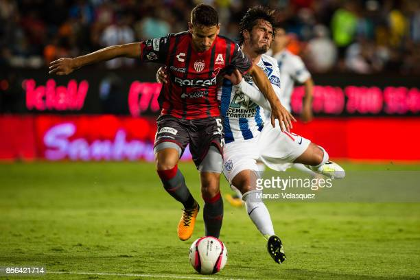 Jorge Hernandez of Pachuca struggles for the ball with Igor Lichnovsky of Necaxa during the 12th round match between Pachuca and Necaxa as part of...