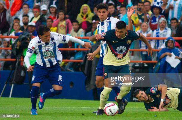 Jorge Hernandez of Pachuca vies for the ball with Silvio Romero of America during their Mexican Apertura 2017 Tournament football match at Hidalgo...