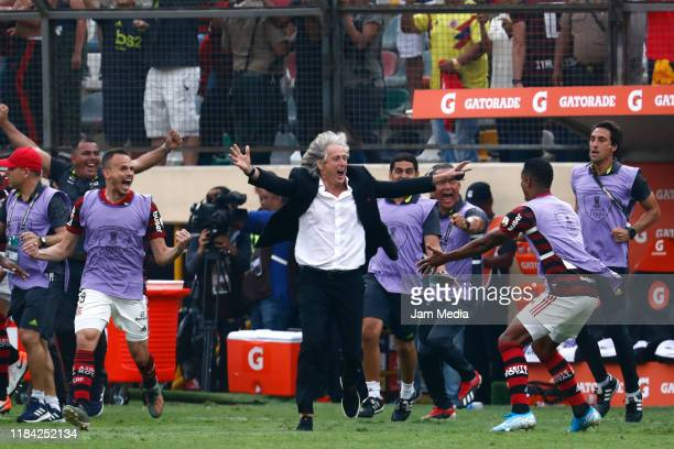 Jorge Jesus coach of Flamengo celetrates with his players after winning the final match of Copa CONMEBOL Libertadores 2019 between Flamengo and River...