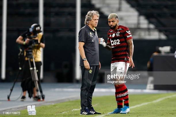 Jorge Jesus coach of Flamengo talks with his player Gabriel Barbosa during a match between Botafogo and Flamengo as part of Brasileirao Series A 2019...