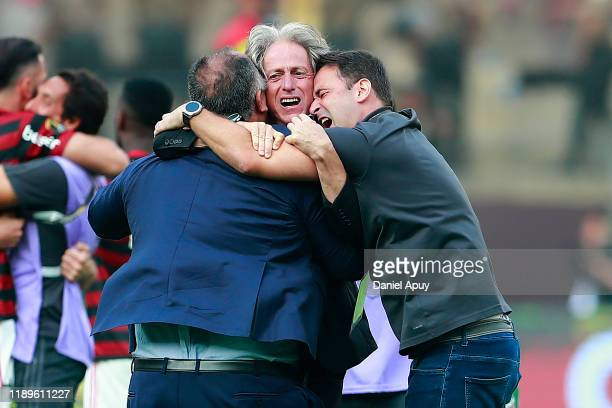 Jorge Jesus head coach of Flamengo celebrates with his staff after winning the final match of Copa CONMEBOL Libertadores 2019 between Flamengo and...