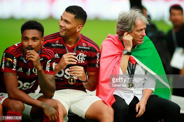 Jorge Jesus head coach of Flamengo sits with this players after receiving the first place medal after the final match of Copa CONMEBOL Libertadores...