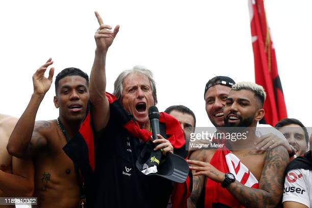 Jorge Jesus head coach of Flamengo talks to fans with players Gabriel Barbosa and Orlando Berrio as on a bus during the celebrations the day after...