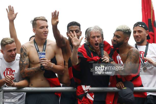 Jorge Jesus head coach of Flamengo talks to the fans with a microphone with Gabriel Barbosa of Flamengo during the celebrations the day after...